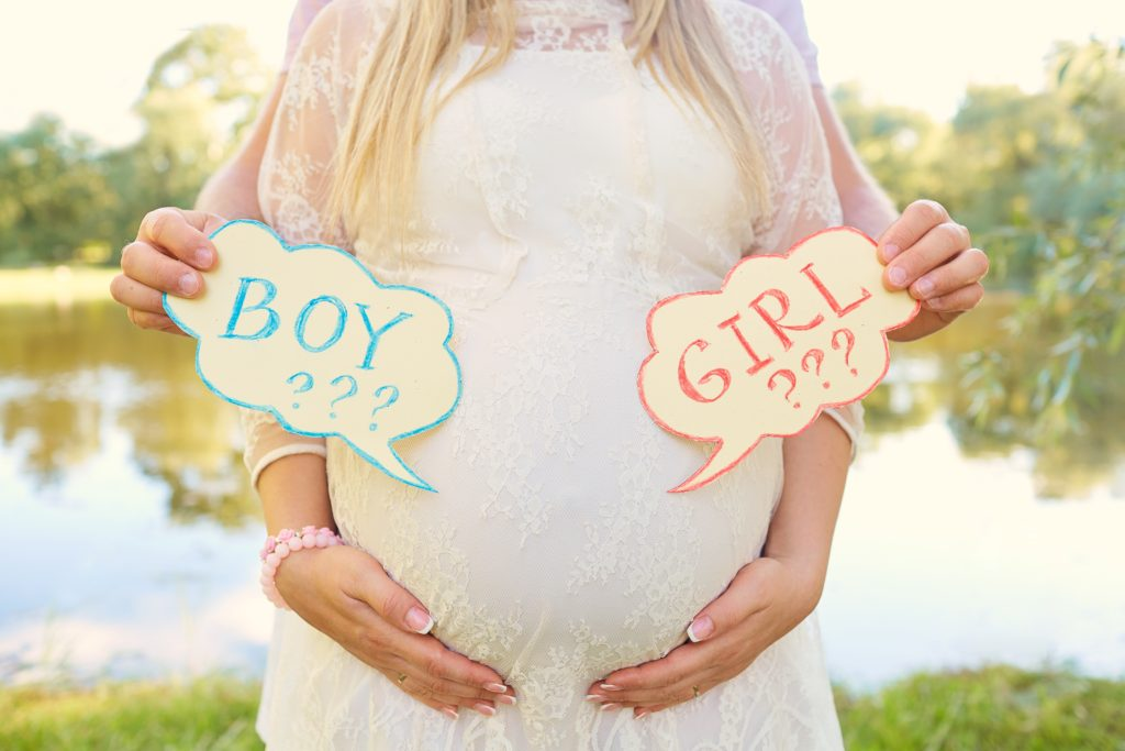 Pregnant couple choosing gender of the baby, the child's name. The problem of choice for a husband and wife.