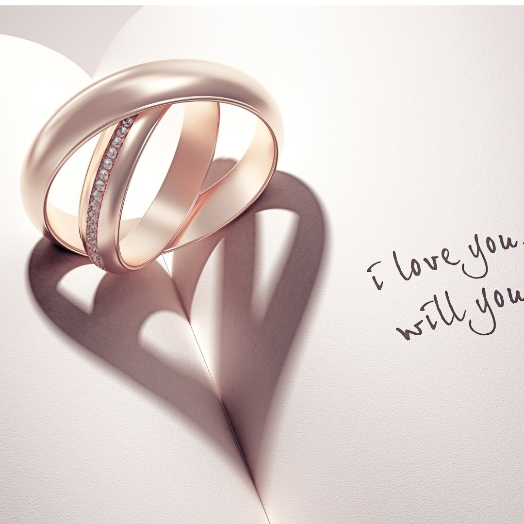 abstract-wedding-rings-with-heartshadow-on-a-book-middle-picture-id495540447